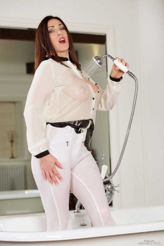 Strict riding mistress Miss Hybrid see through blouse.
