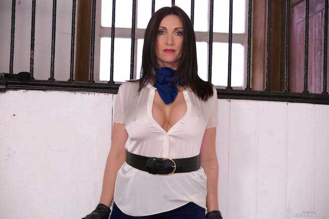 Miss hybrid leather gloves boots and riding crop.